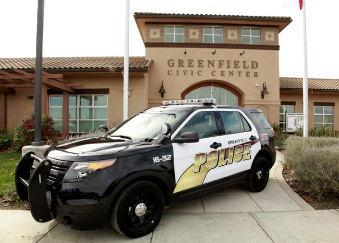 A police cruiser in front of the Greenfield Civic Center.