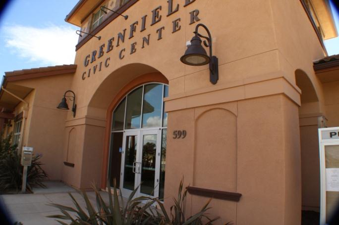 The Greenfield Civic Center. It is a tan building with glass doors.